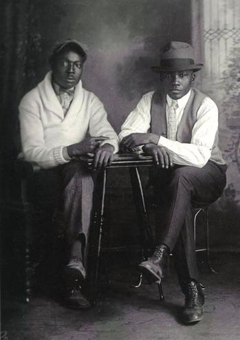 2 gentlemen sitting down