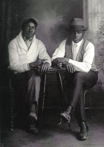 2 gentlemen sitting down